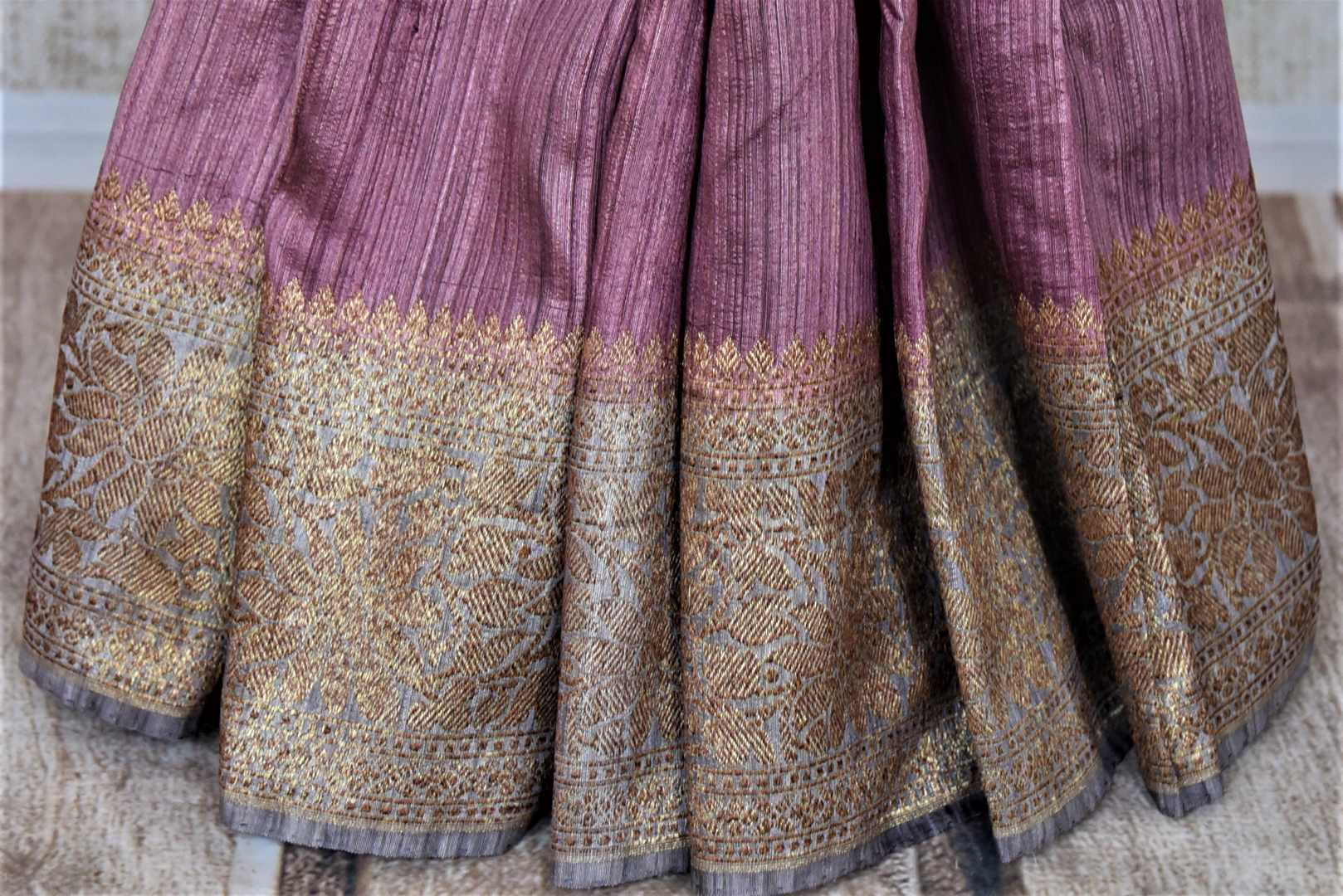 Buy stunning mauve tussar Banarsi saree online in USA with grey antique zari border. Choose tasteful handloom sarees for special occasions from Pure Elegance. Our exclusive Indian fashion store has a myriad of exquisite pure silk saris, tussar sarees, Banarasi sarees for Indian women in USA.-pleats
