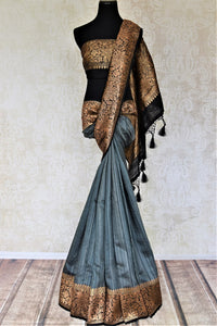 Buy beautiful dark grey tussar Banarasi saree online in USA with antique golden zari border. For Indian women in USA, Pure Elegance Indian fashion store brings an exquisite collection Banarasi sarees, Banarasi silk sarees, tussar sarees, zari work sarees, pure silk sarees all under one roof. Shop online now.-full view