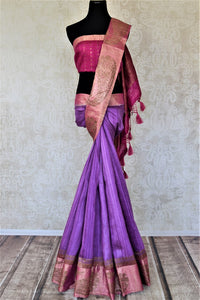 Shop stunning lavender tussar Banarasi sari online in USA with antique zari pink border. For Indian women in USA, Pure Elegance Indian fashion store brings an exquisite collection Banarasi sarees, Banarasi silk sarees, tussar sarees,  work sarees, pure silk sarees all under one roof. Shop online now.-full view