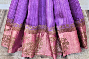 Shop stunning lavender tussar Banarasi sari online in USA with antique zari pink border. For Indian women in USA, Pure Elegance Indian fashion store brings an exquisite collection Banarasi sarees, Banarasi silk sarees, tussar sarees,  work sarees, pure silk sarees all under one roof. Shop online now.-pleats