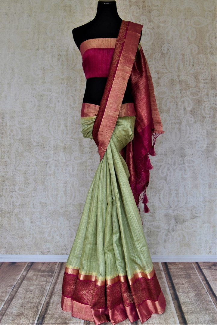 Shop beautiful mint green tussar Banarsi saree online in USA with pink antique zari border. Choose tasteful handloom sarees for special occasions from Pure Elegance. Our exclusive Indian fashion store has a myriad of exquisite pure silk saris, tussar sarees, Banarasi sarees for Indian women in USA.-full view