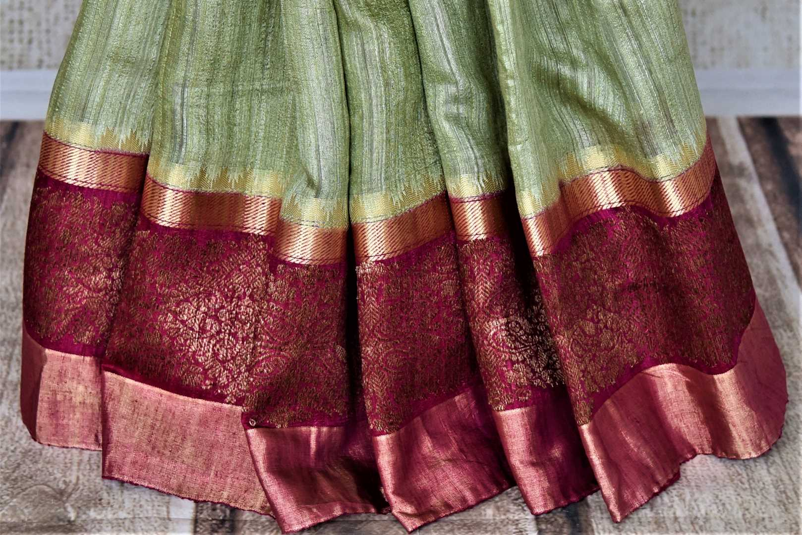 Shop beautiful mint green tussar Banarsi saree online in USA with pink antique zari border. Choose tasteful handloom sarees for special occasions from Pure Elegance. Our exclusive Indian fashion store has a myriad of exquisite pure silk saris, tussar sarees, Banarasi sarees for Indian women in USA.-pleats