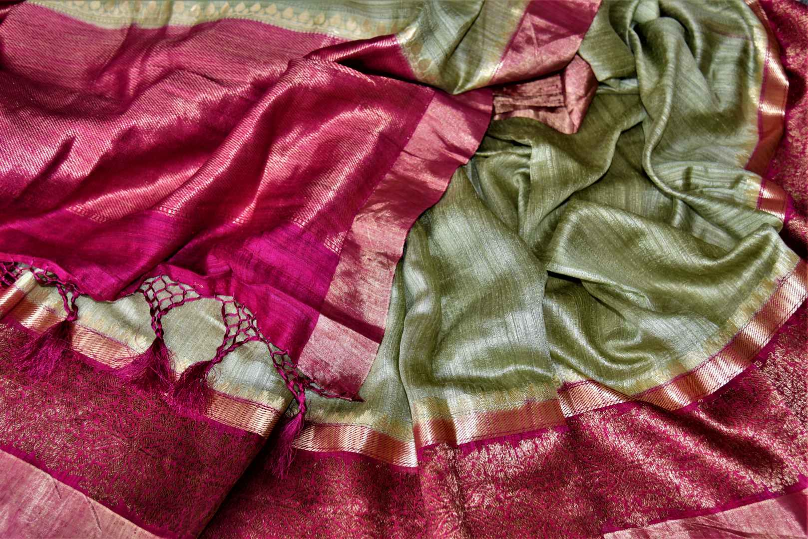 Shop beautiful mint green tussar Banarsi saree online in USA with pink antique zari border. Choose tasteful handloom sarees for special occasions from Pure Elegance. Our exclusive Indian fashion store has a myriad of exquisite pure silk saris, tussar sarees, Banarasi sarees for Indian women in USA.-details