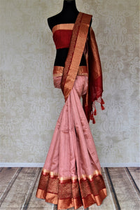 Shop beautiful dusty pink tussar Banarsi sari online in USA with red antique zari border. Choose tasteful handloom saris for special occasions from Pure Elegance. Our exclusive Indian fashion store has a myriad of exquisite pure silk saris, tussar sarees, Banarasi sarees for Indian women in USA.-full view