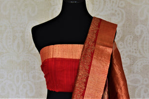 Shop beautiful dusty pink tussar Banarsi sari online in USA with red antique zari border. Choose tasteful handloom saris for special occasions from Pure Elegance. Our exclusive Indian fashion store has a myriad of exquisite pure silk saris, tussar sarees, Banarasi sarees for Indian women in USA.-blouse pallu