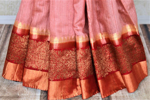 Shop beautiful dusty pink tussar Banarsi sari online in USA with red antique zari border. Choose tasteful handloom saris for special occasions from Pure Elegance. Our exclusive Indian fashion store has a myriad of exquisite pure silk saris, tussar sarees, Banarasi sarees for Indian women in USA.-pleats