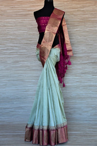 Shop stunning mint green tassar Banarasi sari online in USA with magenta antique zari buta border. Go for a distinct and tasteful saree style on special occasions with handwoven sarees, pure Banarasi saris from Pure Elegance Indian fashion store in USA.-full view