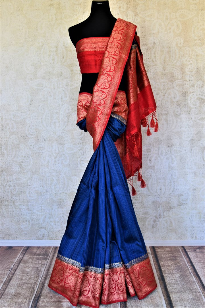 Shop beautiful indigo tussar Benarasi saree online in USA with red antique zari border. Keep your ethnic style updated with latest designer saris, handloom sarees, pure silk sarees from Pure Elegance Indian fashion store in USA.-full view