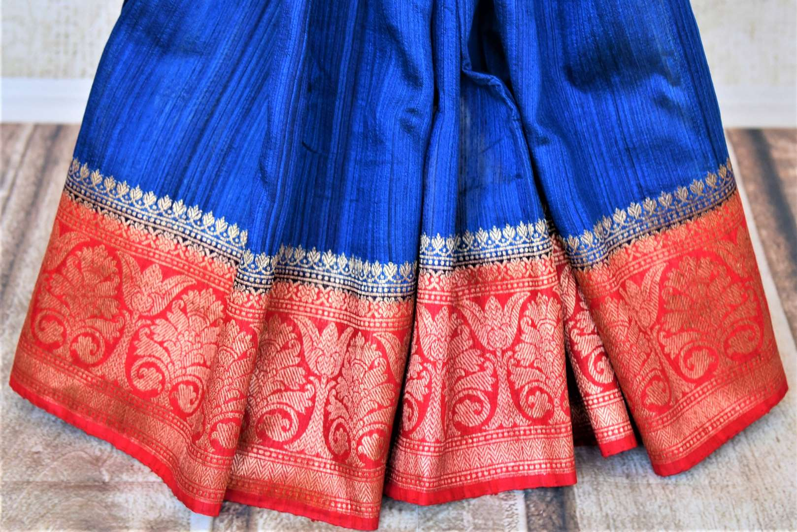 Shop beautiful indigo tussar Benarasi saree online in USA with red antique zari border. Keep your ethnic style updated with latest designer saris, handloom sarees, pure silk sarees from Pure Elegance Indian fashion store in USA.-pleats