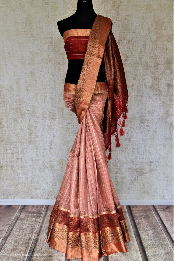 Shop beautiful dusty pink zari check tussar Banarasi saree online in USA with red zari pallu. Choose tasteful handloom saris for special occasions from Pure Elegance. Our exclusive Indian fashion store has a myriad of exquisite pure silk saris, tussar sarees, Banarasi sarees for Indian women in USA.-full view