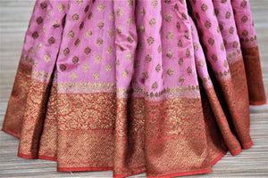 Buy beautiful pink muga Banarasi sari online in USA with red antique zari border. Be an epitome of ethnic Indian fashion with traditional Banarasi sarees, georgette saris from Pure Elegance fashion store in USA.-pleats
