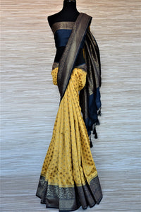 Buy stunning yellow muga Banarasi saree online in USA with blue antique zari border. Be an epitome of ethnic Indian fashion with traditional Banarasi sarees, georgette saris from Pure Elegance fashion store in USA.-full view