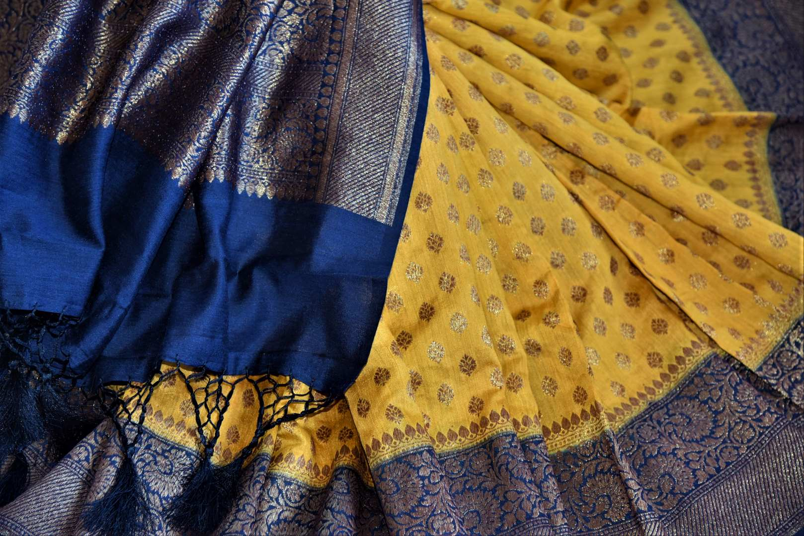 Buy stunning yellow muga Banarasi saree online in USA with blue antique zari border. Be an epitome of ethnic Indian fashion with traditional Banarasi sarees, georgette saris from Pure Elegance fashion store in USA.-details