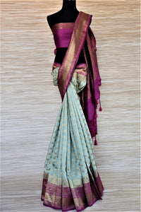 Buy tea green muga silk sari online in USA with purple antique zari border. Be an epitome of ethnic Indian fashion with traditional Banarasi sarees, georgette saris from Pure Elegance fashion store in USA.-full view