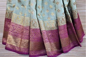 Buy tea green muga silk sari online in USA with purple antique zari border. Be an epitome of ethnic Indian fashion with traditional Banarasi sarees, georgette saris from Pure Elegance fashion store in USA.-pleats
