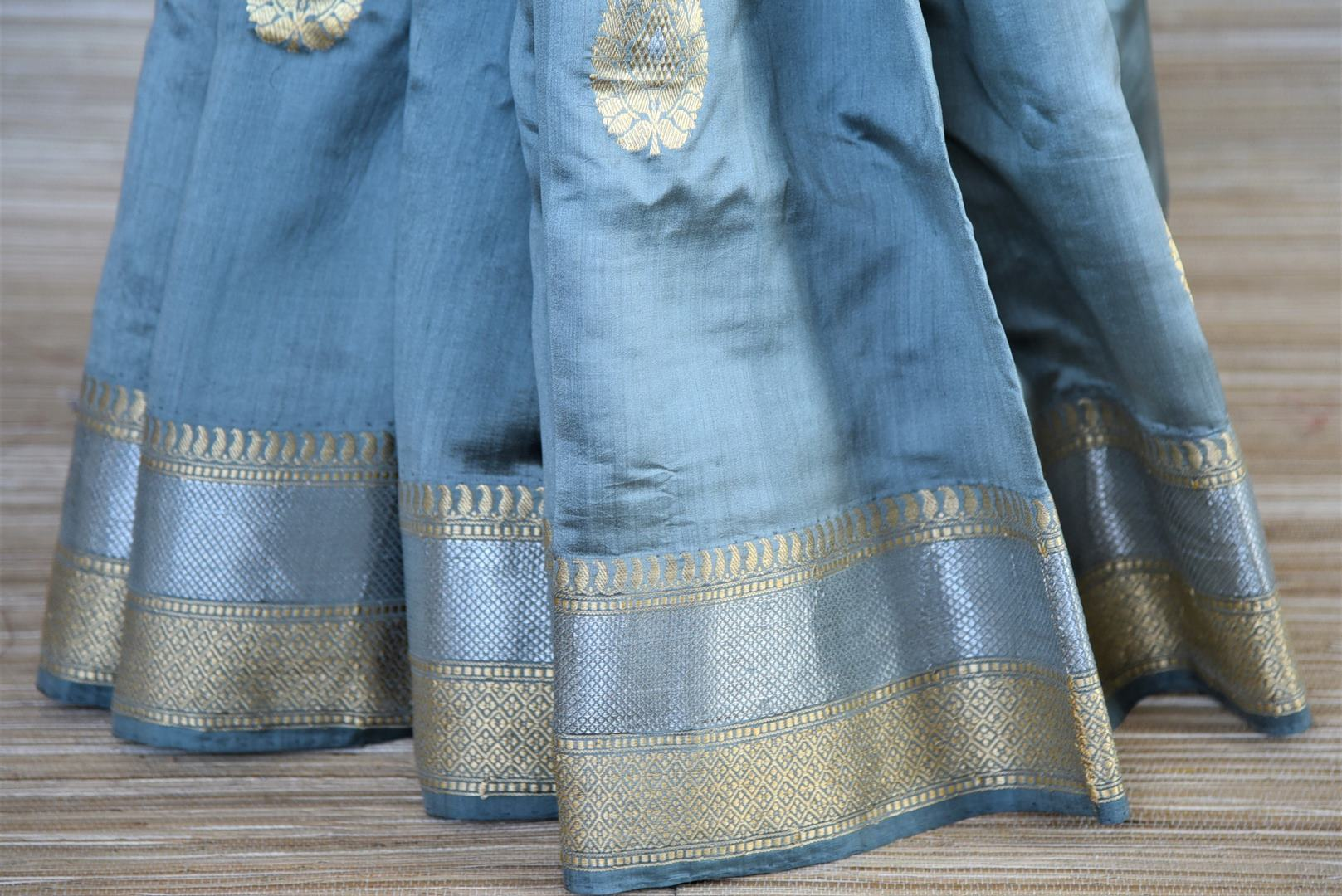 Buy greyish blue Banarasi silk saree online in USA with silver zari border. Dazzle on weddings and special occasions with exquisite Indian designer sarees, Banarasi sarees from Pure Elegance Indian fashion store in USA.-pleats