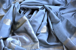 Buy greyish blue Banarasi silk saree online in USA with silver zari border. Dazzle on weddings and special occasions with exquisite Indian designer sarees, Banarasi sarees from Pure Elegance Indian fashion store in USA.-details