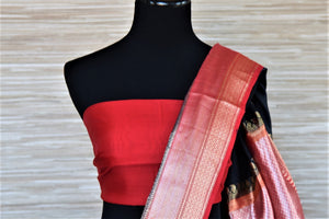 Shop gorgeous black Banarasi silk sari online in USA with red zari border and buta. Be a vision of tradition and elegance on weddings and festivals with exquisite Banarasi silk sarees, pure silk sarees, handwoven sarees from Pure Elegance Indian clothing store in USA.-blouse pallu