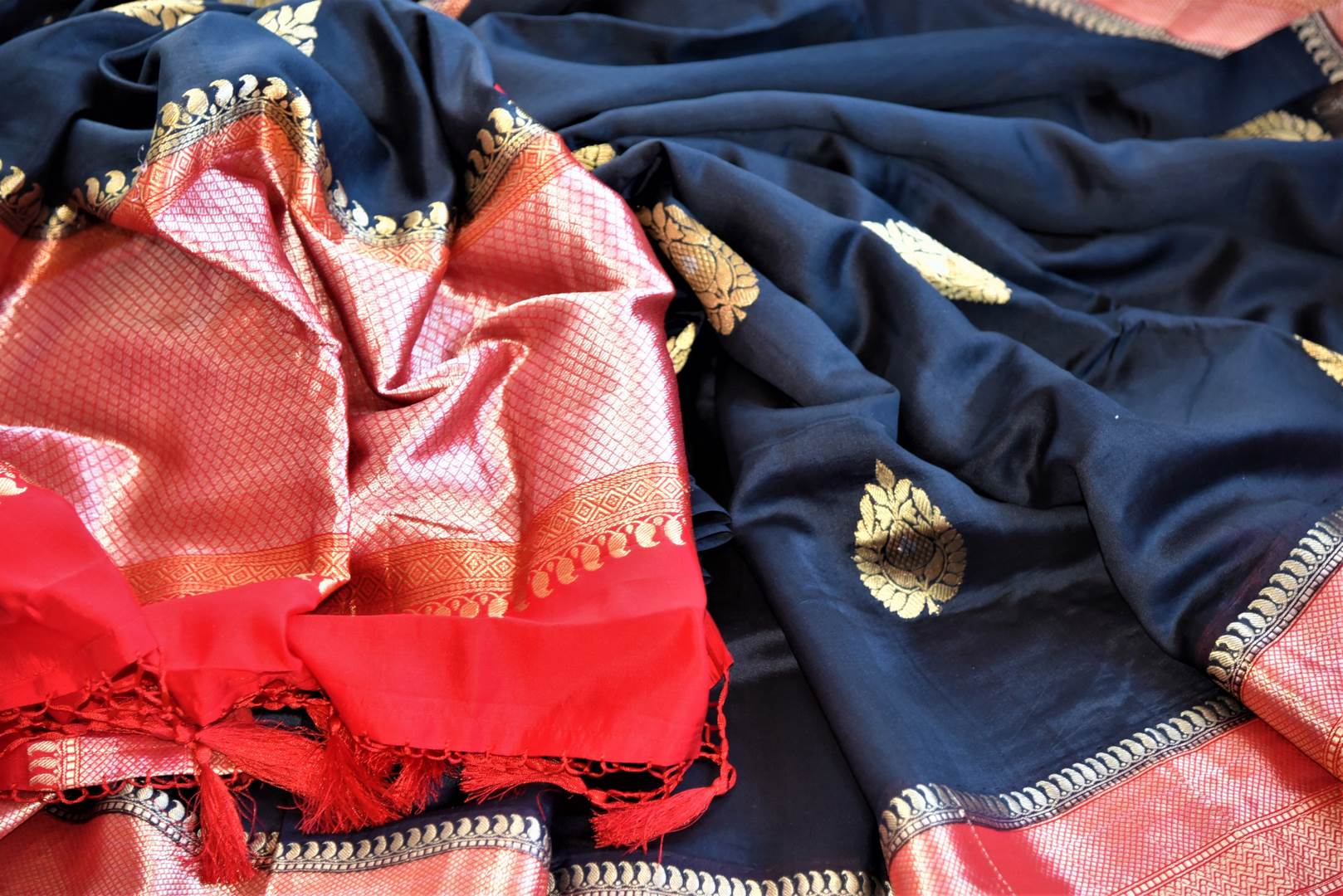 Shop gorgeous black Banarasi silk sari online in USA with red zari border and buta. Be a vision of tradition and elegance on weddings and festivals with exquisite Banarasi silk sarees, pure silk sarees, handwoven sarees from Pure Elegance Indian clothing store in USA.-details