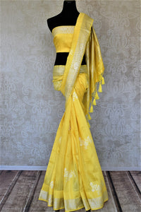 Buy beautiful lemon yellow tussar Benarasi sari online in USA with silver zari border. For Indian women in USA, Pure Elegance Indian fashion store brings an exquisite collection Banarasi sarees, Banarasi silk saris, tussar sarees,  work sarees, pure silk sarees all under one roof. Shop online now.-full view