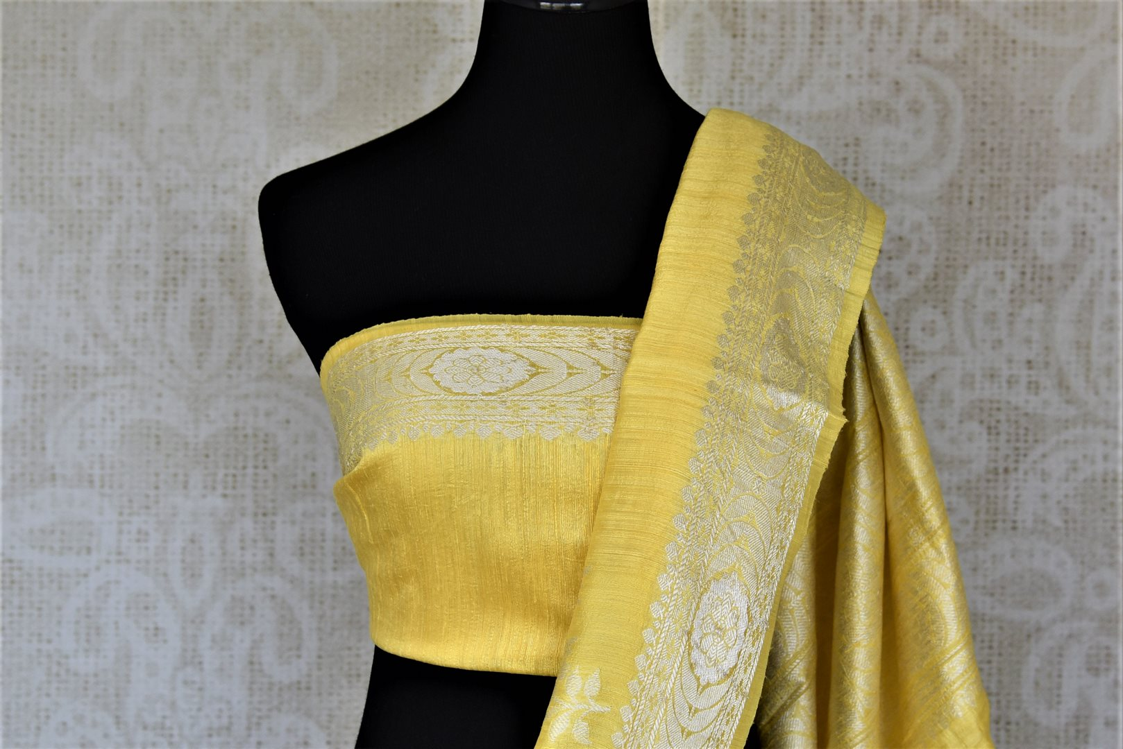 Buy beautiful lemon yellow tussar Benarasi sari online in USA with silver zari border. For Indian women in USA, Pure Elegance Indian fashion store brings an exquisite collection Banarasi sarees, Banarasi silk saris, tussar sarees,  work sarees, pure silk sarees all under one roof. Shop online now.-blouse pallu