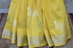 Buy beautiful lemon yellow tussar Benarasi sari online in USA with silver zari border. For Indian women in USA, Pure Elegance Indian fashion store brings an exquisite collection Banarasi sarees, Banarasi silk saris, tussar sarees,  work sarees, pure silk sarees all under one roof. Shop online now.-pleats