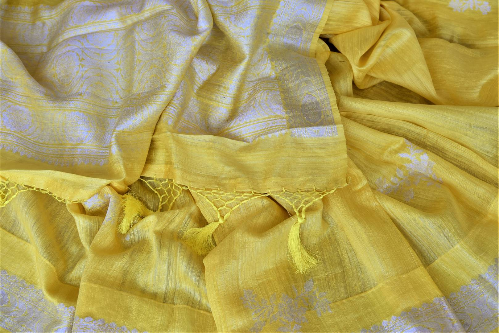 Buy beautiful lemon yellow tussar Benarasi sari online in USA with silver zari border. For Indian women in USA, Pure Elegance Indian fashion store brings an exquisite collection Banarasi sarees, Banarasi silk saris, tussar sarees,  work sarees, pure silk sarees all under one roof. Shop online now.-details