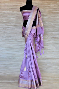Buy lavender color Banarasi silk saree online in USA with silver golden zari border and buta. Be a vision of tradition and elegance on weddings and festivals with exquisite Banarasi silk sarees, pure silk sarees, handwoven sarees from Pure Elegance Indian clothing store in USA.-full view