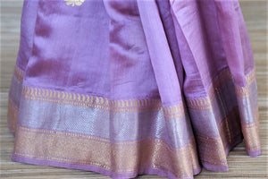 Buy lavender color Banarasi silk saree online in USA with silver golden zari border and buta. Be a vision of tradition and elegance on weddings and festivals with exquisite Banarasi silk sarees, pure silk sarees, handwoven sarees from Pure Elegance Indian clothing store in USA.-pleats
