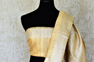 Buy attractive yellow tussar Banarasi sari online in USA with silver zari border and zari buta. Be the center of attraction at weddings and parties with beautiful silk sarees, tussar sarees, embroidered sarees, partywear sarees, fancy sarees from Pure Elegance Indian fashion store in USA. -blouse pallu