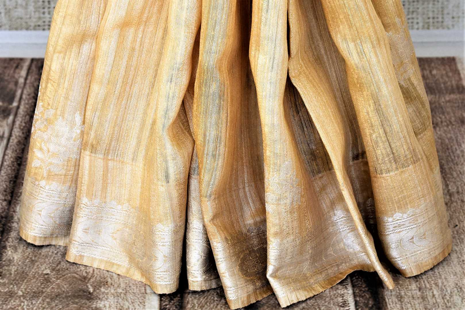 Buy attractive yellow tussar Banarasi sari online in USA with silver zari border and zari buta. Be the center of attraction at weddings and parties with beautiful silk sarees, tussar sarees, embroidered sarees, partywear sarees, fancy sarees from Pure Elegance Indian fashion store in USA. -pleats