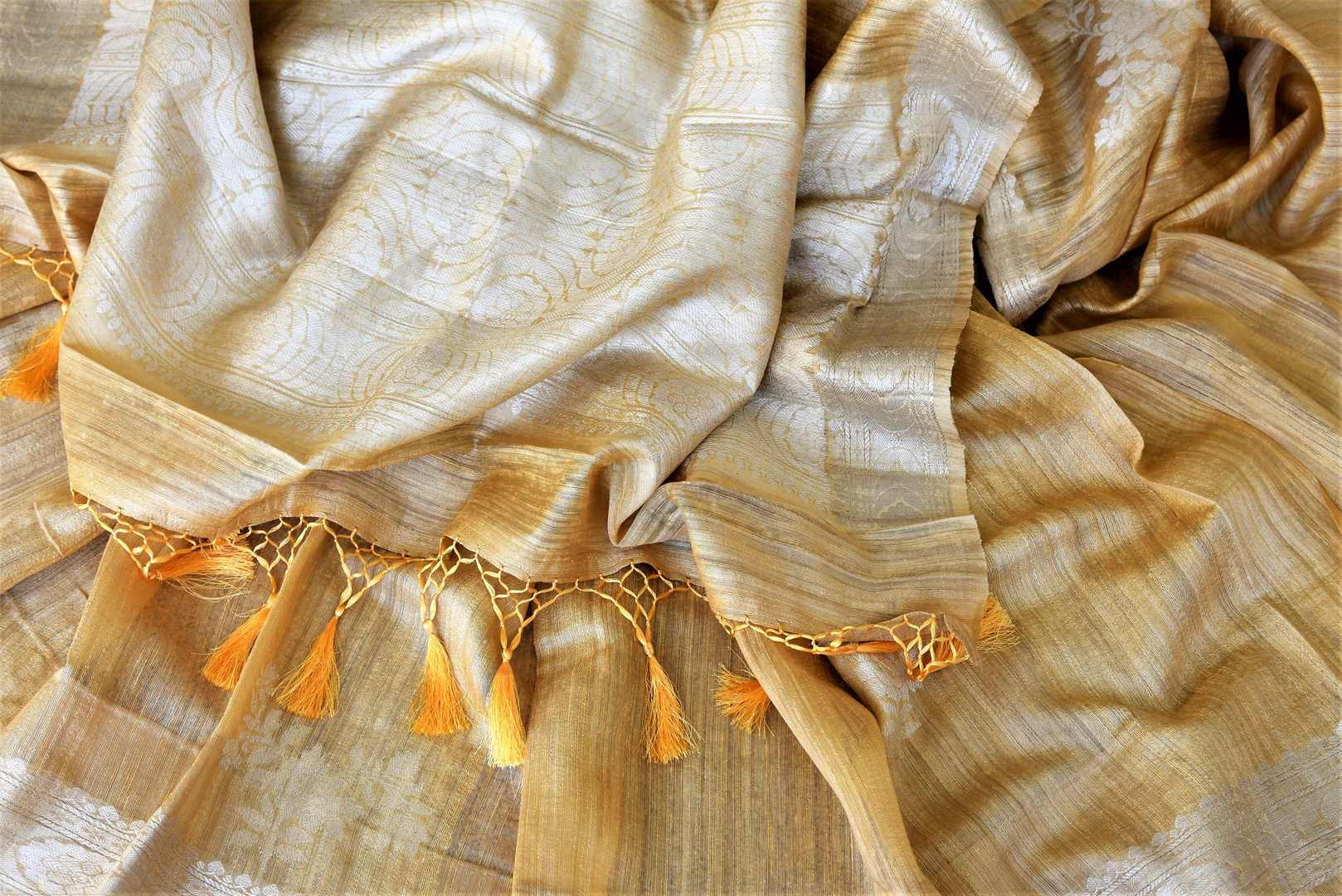 Buy attractive yellow tussar Banarasi sari online in USA with silver zari border and zari buta. Be the center of attraction at weddings and parties with beautiful silk sarees, tussar sarees, embroidered sarees, partywear sarees, fancy sarees from Pure Elegance Indian fashion store in USA. -details