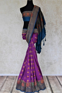 Shop gorgeous purple muga Banarasi saree online in USA with blue antique zari floral border. Keep your ethnic style updated with latest designer sarees, handloom sarees, pure silk sarees from Pure Elegance Indian fashion store in USA.-full view