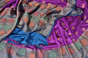 Shop gorgeous purple muga Banarasi saree online in USA with blue antique zari floral border. Keep your ethnic style updated with latest designer sarees, handloom sarees, pure silk sarees from Pure Elegance Indian fashion store in USA.-details