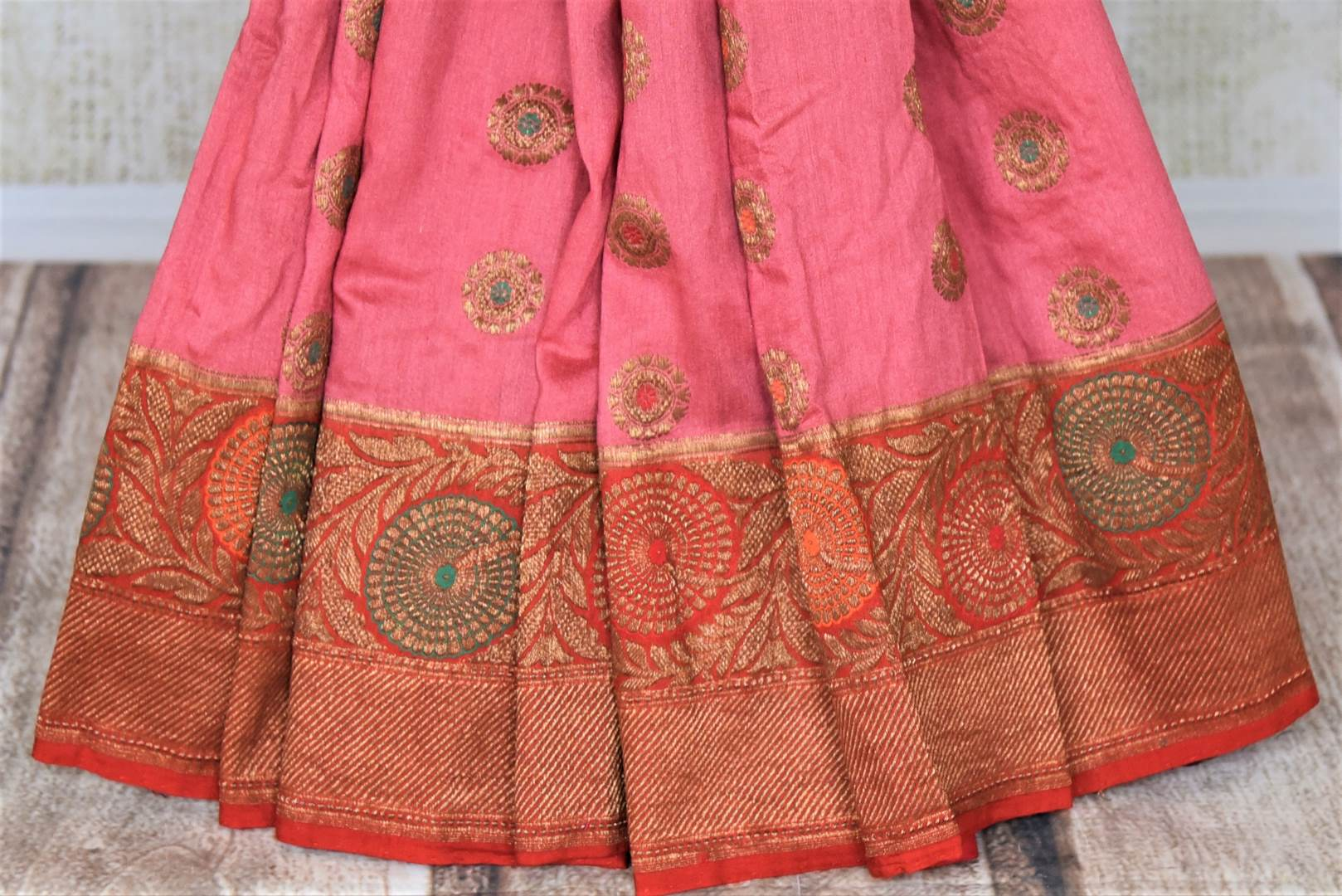Shop attractive pink muga Banarasi saree online in USA with red antique zari floral border. Keep your ethnic style updated with latest designer sarees, handloom sarees, pure silk sarees from Pure Elegance Indian fashion store in USA.-pleats
