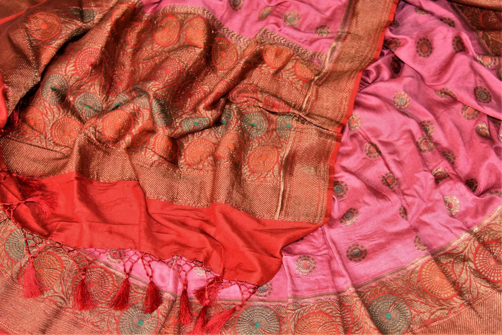 Shop attractive pink muga Banarasi saree online in USA with red antique zari floral border. Keep your ethnic style updated with latest designer sarees, handloom sarees, pure silk sarees from Pure Elegance Indian fashion store in USA.-details