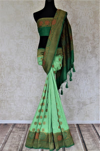 Buy pastel green muga Banarasi sari online in USA with dark green antique zari floral border. Keep your ethnic style updated with latest designer sarees, handloom sarees, pure silk sarees from Pure Elegance Indian fashion store in USA.-full view