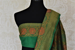 Buy pastel green muga Banarasi sari online in USA with dark green antique zari floral border. Keep your ethnic style updated with latest designer sarees, handloom sarees, pure silk sarees from Pure Elegance Indian fashion store in USA.-blouse pallu