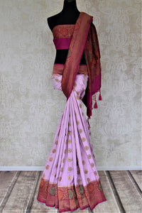 Shop lavender muga Banarasi saree online in USA with magenta antique zari floral border. Keep your ethnic style updated with latest designer sarees, handloom sarees, pure silk sarees from Pure Elegance Indian fashion store in USA.-full view