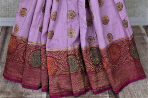 Shop lavender muga Banarasi saree online in USA with magenta antique zari floral border. Keep your ethnic style updated with latest designer sarees, handloom sarees, pure silk sarees from Pure Elegance Indian fashion store in USA.-pleats