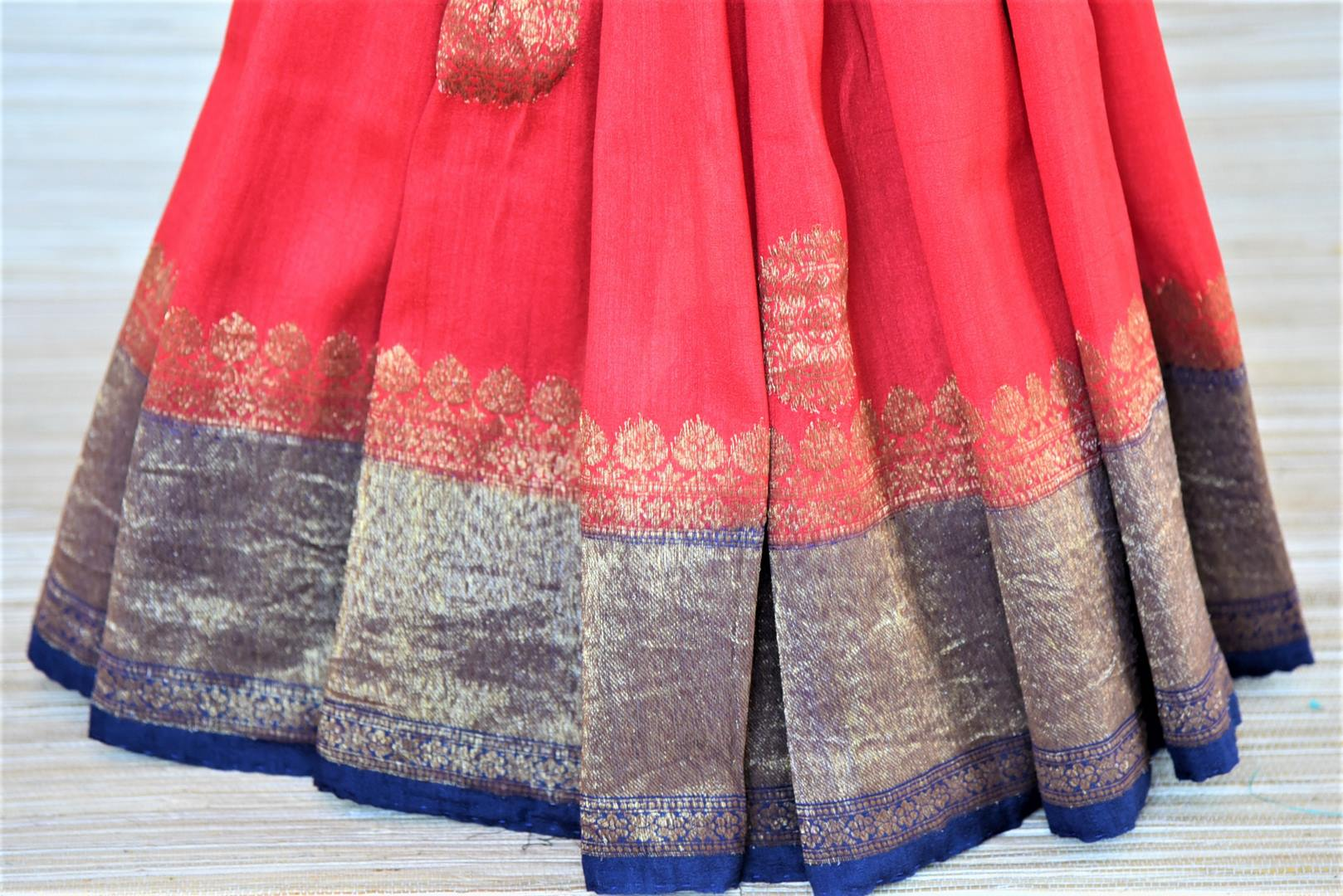 Buy red tussar Banarsi saree online in USA with blue antique zari border. Wear designer sarees, Banarasi sarees, handwoven tussar sarees on special occasions from Pure Elegance Indian clothing store in USA. -pleats