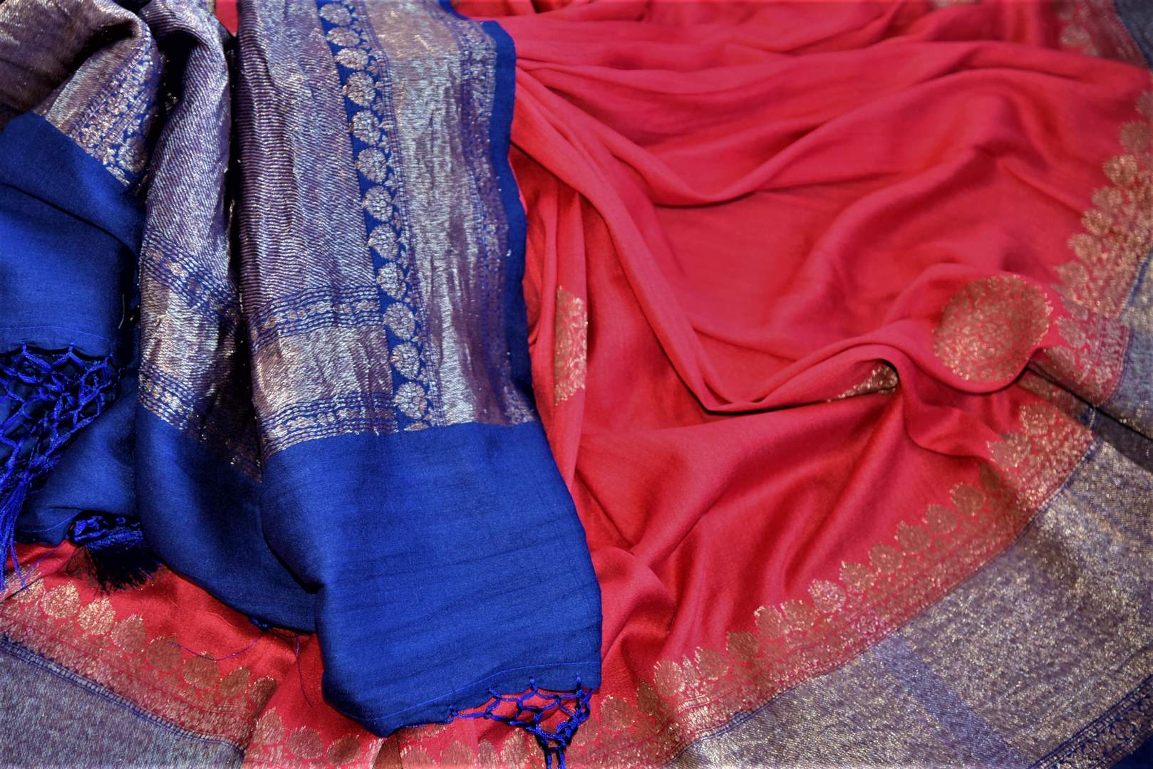 Buy red tussar Banarsi saree online in USA with blue antique zari border. Wear designer sarees, Banarasi sarees, handwoven tussar sarees on special occasions from Pure Elegance Indian clothing store in USA. -details