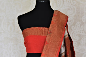 Buy lovely off-white muga Banarasi saree online in USA with red antique zari floral border. Keep your ethnic style updated with latest designer sarees, handloom sarees, pure silk sarees from Pure Elegance Indian fashion store in USA.-blouse pallu