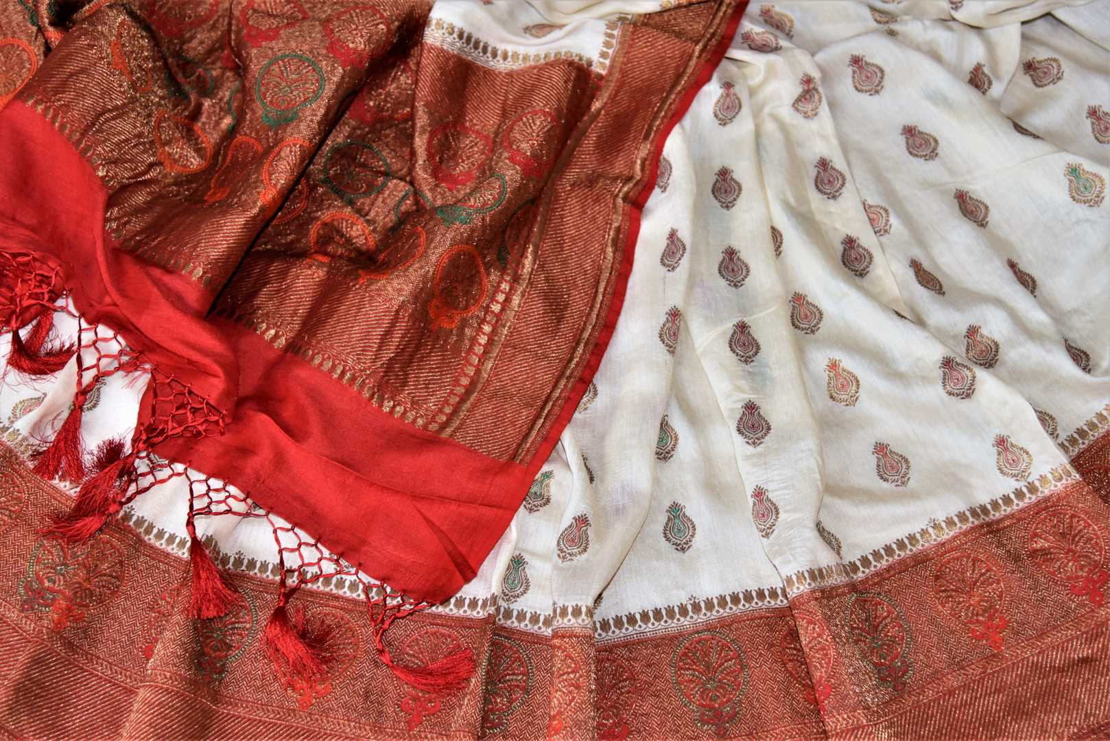 Buy lovely off-white muga Banarasi saree online in USA with red antique zari floral border. Keep your ethnic style updated with latest designer sarees, handloom sarees, pure silk sarees from Pure Elegance Indian fashion store in USA.-details