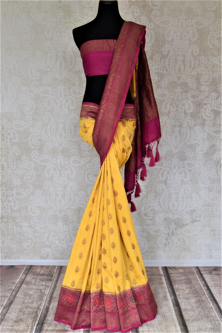 Buy striking yellow muga Banarasi saree online in USA with magenta antique zari floral border. Keep your ethnic style updated with latest designer sarees, handloom sarees, pure silk sarees from Pure Elegance Indian fashion store in USA.-full view
