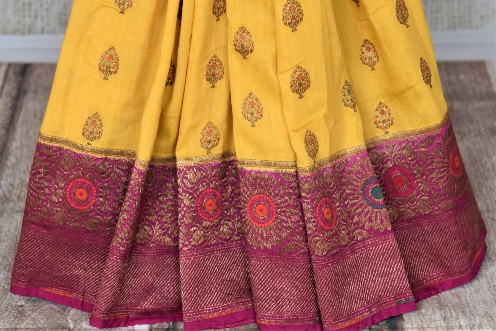 Buy striking yellow muga Banarasi saree online in USA with magenta antique zari floral border. Keep your ethnic style updated with latest designer sarees, handloom sarees, pure silk sarees from Pure Elegance Indian fashion store in USA.-pleats
