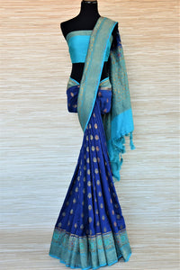 Shop indigo muga Banarasi sari online in USA with antique zari minakari blue border and buta. Be a vision of tradition and elegance on weddings and festivals with exquisite Banarasi silk sarees, muga silk sarees, handwoven sarees from Pure Elegance Indian clothing store in USA.-full view