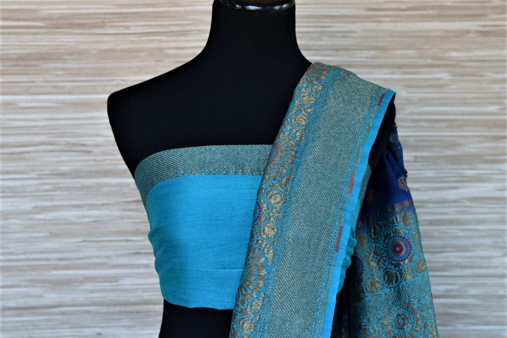 Shop indigo muga Banarasi sari online in USA with antique zari minakari blue border and buta. Be a vision of tradition and elegance on weddings and festivals with exquisite Banarasi silk sarees, muga silk sarees, handwoven sarees from Pure Elegance Indian clothing store in USA.-blouse pallu