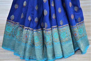 Shop indigo muga Banarasi sari online in USA with antique zari minakari blue border and buta. Be a vision of tradition and elegance on weddings and festivals with exquisite Banarasi silk sarees, muga silk sarees, handwoven sarees from Pure Elegance Indian clothing store in USA.-pleats