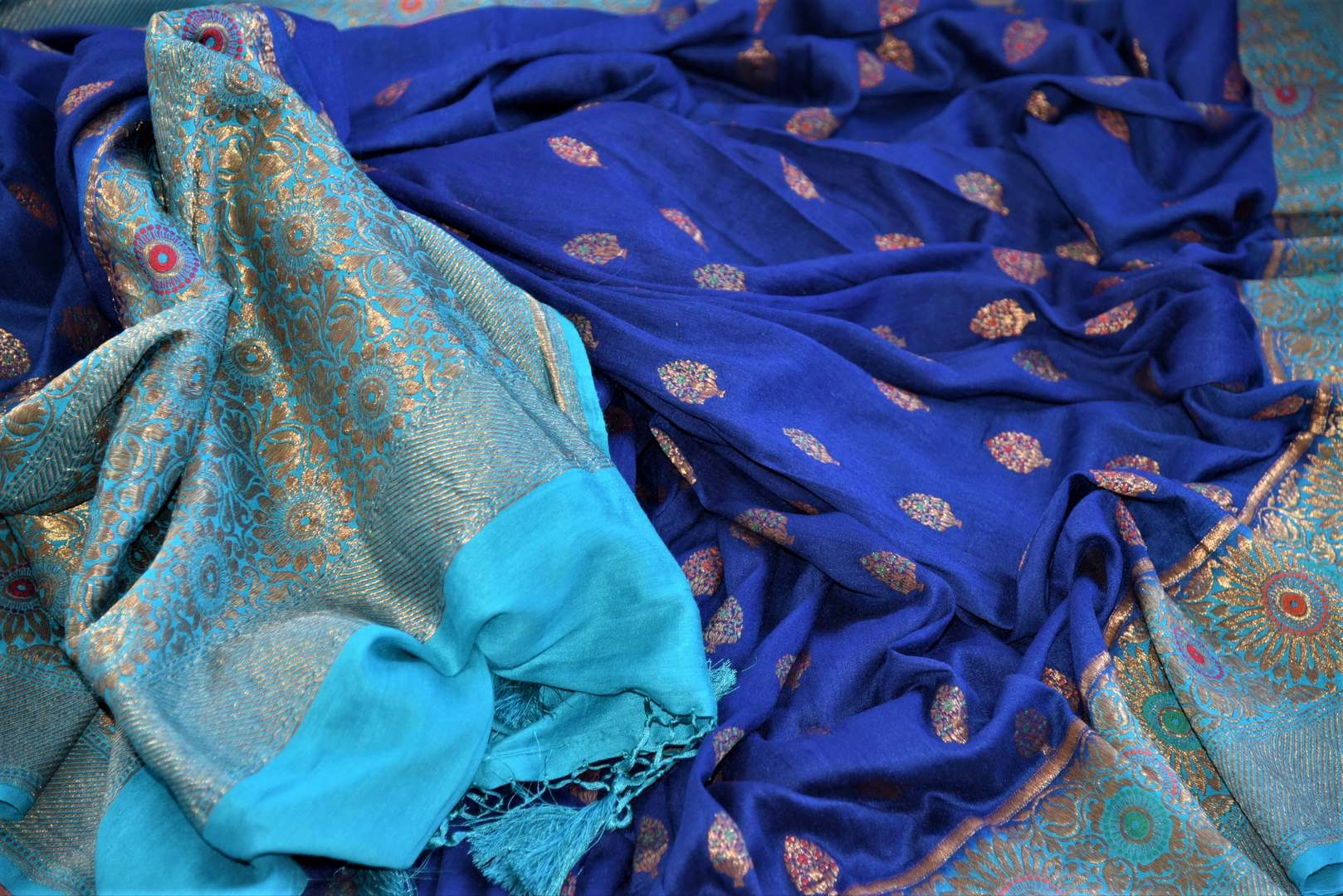 Shop indigo muga Banarasi sari online in USA with antique zari minakari blue border and buta. Be a vision of tradition and elegance on weddings and festivals with exquisite Banarasi silk sarees, muga silk sarees, handwoven sarees from Pure Elegance Indian clothing store in USA.-details